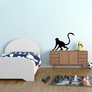מדבקת קיר לחדר ילדים קוף שחור על קיר בצבע תכלת